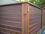 horizontal wood/copper fence and